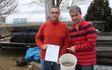 Water Wells First spokesperson Kevin Jakubec posing with Paul Brooks at 9597 Brook Line. January 23, 2018. (Photo by Sarah Cowan Blackburn News Chatham-Kent).