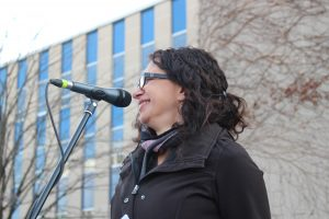 Pat Papadeas addresses the crowd at Windsor's Women's March, March 9. (Photo by Adelle Loiselle)