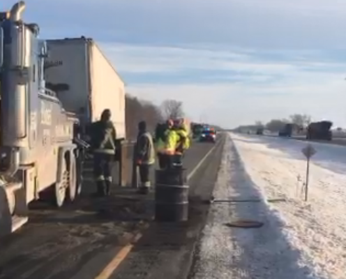 Crews work to tow the trailer from a transport truck that was involved in a crash on Hwy. 401 at Currie Rd., February 13, 2018. Photo courtesy of the OPP.