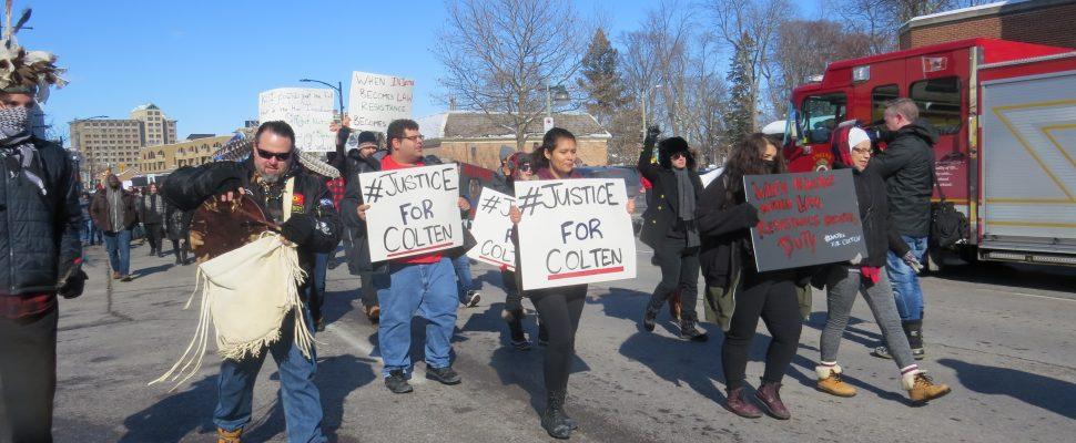Dozens of supporters of Colten Boushie marched down Richmond St. in London, February 12, 2018. (Photo by Miranda Chant, Blackburn News)