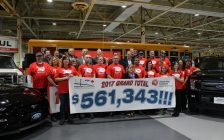 Ford employee reveal their total donation to the United Way campaign, February 15, 2018. (Photo by Maureen Revait)