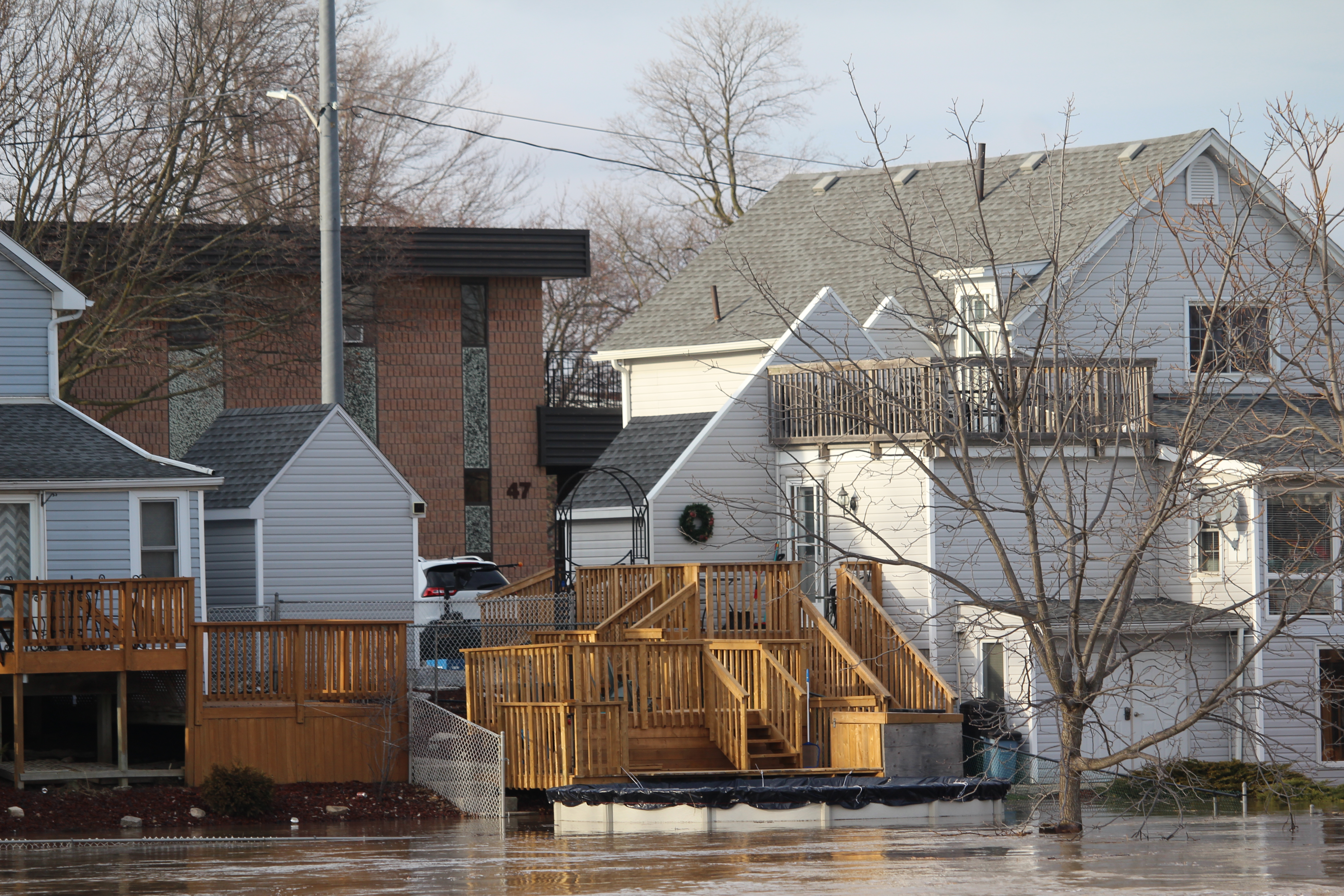The Thames River floods several residents' backyards across from the Chatham-Kent Civic Centre. February 24, 2018. (Photo by Matt Weverink)