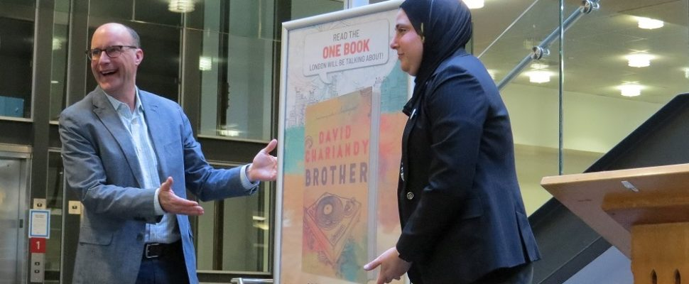 Mayor Matt Brown unveils the One Book One London selection, Brother by Canadian author David Chariandy at the Central Library Branch, February 5, 2018. (Photo by Miranda Chant, Blackburn News)
