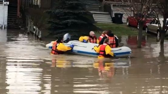 Chatham-Kent fire and emergency crews rescue a family of five from their flooded home in Chatham. February 24, 2018. (Photo courtesy of Chatham-Kent Fire and Emergency Services)