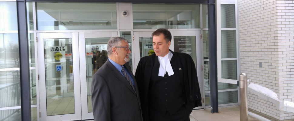 Pat Cayen speaks with defense counsel Phillip Millar outside the Sarnia Courthouse. March 15, 2018. (Photo by Colin Gowdy, Blackburn News)