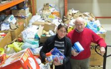 London Food Bank Co-Executive Directors Jane Roy and Glen Pearson surrounded by donations at the food bank warehouse on Leathorne St., March 23, 2018. (Photo by Miranda Chant, Blackburn News)