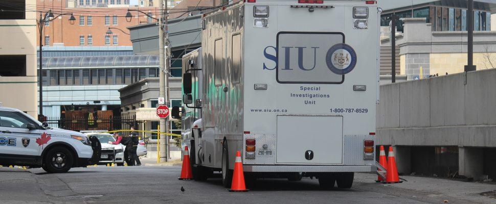 The Special Investigations Unit investigating a scene in downtown Windsor, March 21, 2018. (Photo by Maureen Revait)