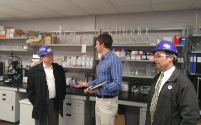 Green Party leader Mike Schreiner (left) and Green Party Sarnia-Lambton candidate Kevin Shaw (right) speak with Bio-Industrial research coordinator Stephen Reaume (middle). March 21, 2018. (Photo by Colin Gowdy, Blackburn News)