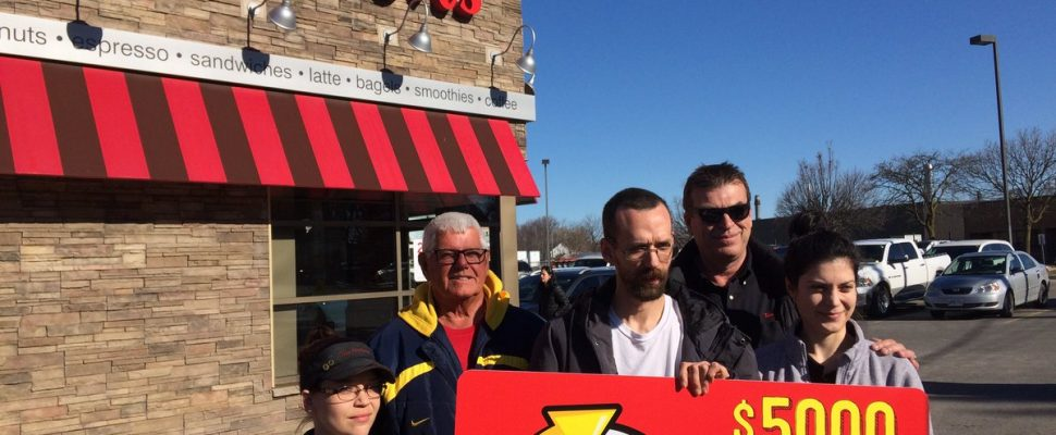 Alan Hudson of Chatham (middle) wins big in this year's 'Roll Up the Rim to Win' contest at Tim Hortons. Mar 05, 2018. (Photo by Paul Pedro)