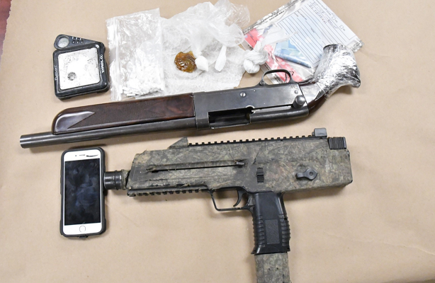 Drugs and guns seized by London police in a raid at a Limberlost Rd. home, March 7, 2018. Photo courtesy of London police.