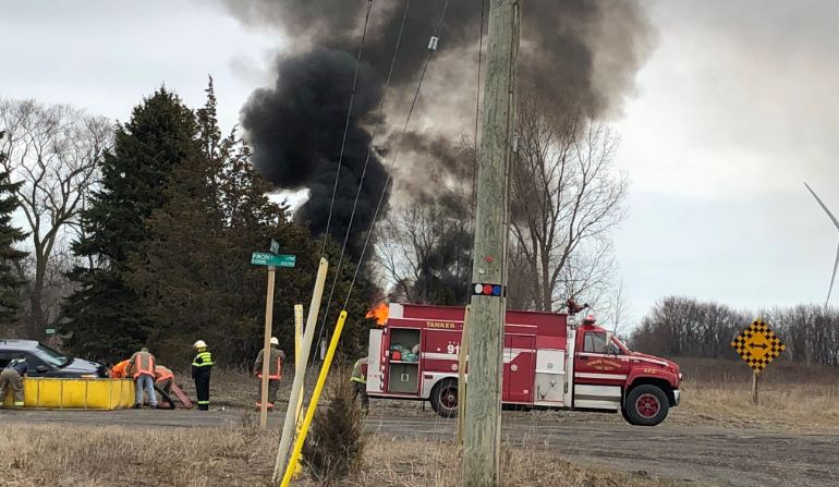 Firefighters battle a blaze at a property near Scane Rd. and Front Line south of Ridgetown. March 28, 2018. (Photo courtesy of Chatham-Kent Fire and Emergency Services via Twitter)