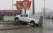 A stolen pickup truck crashed into a restaurant sign at Wharncliffe Rd., near Riverside Dr., March 7, 2018. (Photo by Miranda Chant, Blackburn News)