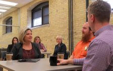 Ontario NDP Leader Andrea Horwath speaks to Western University students Jody Tomchishen (centre) and Stuart McHenry at Innovation Works, April 18, 2018. (Photo by Miranda Chant, Blackburn News)