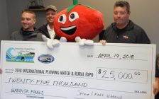 Jaymie Waddick (R) and Ian Waddick (left, representing Mark Waddick) of Waddick fuels present a cheque representing the $25,000 in fuel the company is donating to fuel the International Plowing Match and Rural Expo 2018. Match Mascot Tobe Cobe Jr and Match Co-Chair Leon Leclair accepted the donation, April 19 2018. (Photo courtesy of the IPM and RE Media Committee)