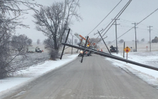 A broken hydro pole hangs over a roadway. Photo from Hydro One via Twitter.