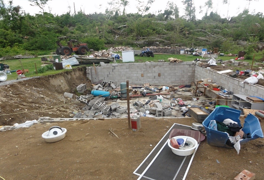 The remaining foundation of a destroyed home in Sainte-Anne-du-Lac observed after a tornado on June 18, 2017. Photo courtesy of www.mediarelations.uwo.ca