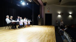 (Left to right) Candidates Andy Bruziewicz, Fanina Kodre, Kevin Shaw, Bob Bailey, Kathy Alexander and speaker Brian White listen to an audience members question during the all candidates debate at the Sarnia Library Theatre. May 16, 2018. (Photo by Colin Gowdy, BlackburnNews)