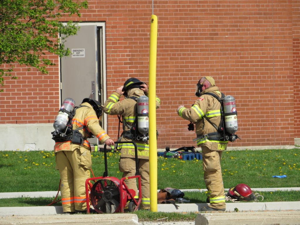 Firefighters respond to the factory at 100 Kellogg Lane after a fire broke out on the fourth floor, May 15, 2018. (Photo by Miranda Chant, BlackburnNews.com)