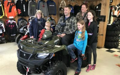 Daley on his new ATV surrounded by his family at Bob's Motor Sports in Chatham,