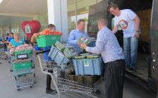Real Canadian Superstore employees load produce and baked goods into the London Food Bank donation van outside of the store at 825 Oxford St., May 30, 2018. (Photo by Miranda Chant, Blackburn News)