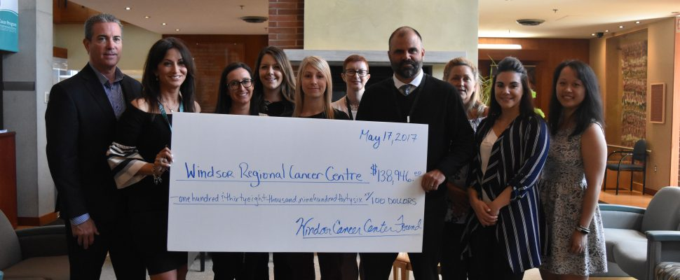 Staff at the Windsor Regional Cancer Centre hold a donation cheque presented by the Windsor Cancer Centre Foundation. (Photo by Alyssa Leonard)