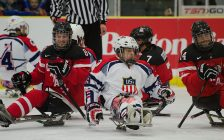 Photo of Canada-US game at the 2015 World Sledge Hockey Challenge. Photo by Connormah, used with a Creative Commons licence.