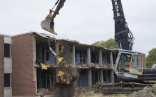 Construction workers tearing down Lambton College's North Building. June 22, 2018. (Photo by Colin Gowdy, BlackburnNews)