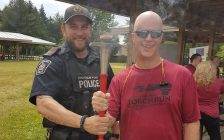 Constable Jason Herder with CFCO Morning Show host Dave Palmer at Law Enforcement Torch Run. June 16, 2018. (Photo courtesy of Dave Palmer).