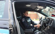 Const. Renee Cowell with the Chatham-Kent Police Service in her cruiser. (Photo by Greg Higgins)