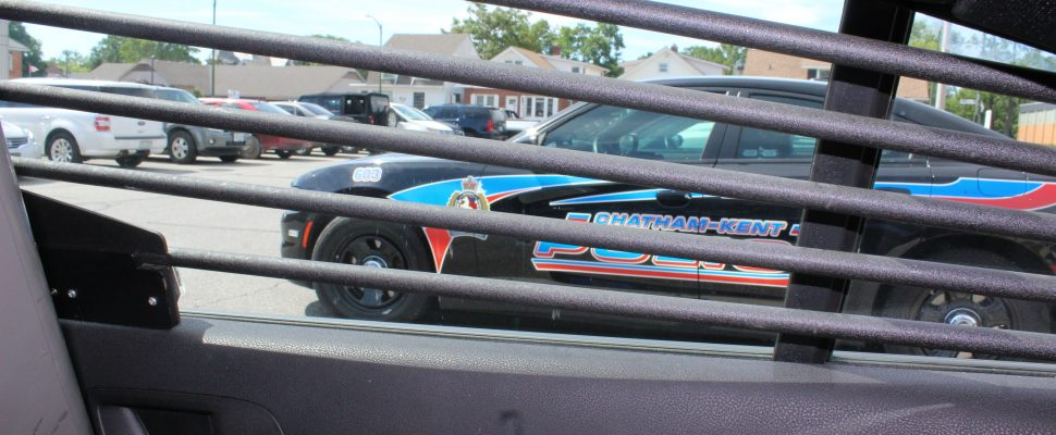 Back of a police cruiser looking out the right window. (Photo by Greg Higgins)