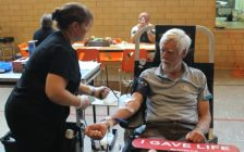 Paul Van Hardeveld rolls up his sleeve and donates blood for the 200th time. june 13, 2018. (Photo by Greg Higgins)