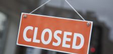 A closed sign hangs in a retail store window. File photo courtesy of © Can Stock Photo / kevers