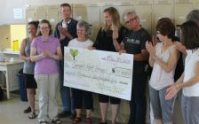 100 Women Who Care present a check to Chatham Hope Haven for the biggest donation in the organizations history since the group was created less than two years ago. June 15, 2018. (Photo by Greg Higgins.)