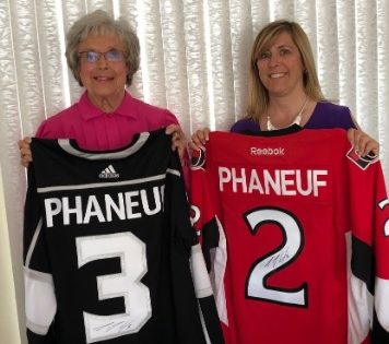 Wilma McNeill and Lesley Coene, St. Joseph's Hospice Fund Development Coordinator, show off Dion Phaneuff raffle jerseys (submitted photo)