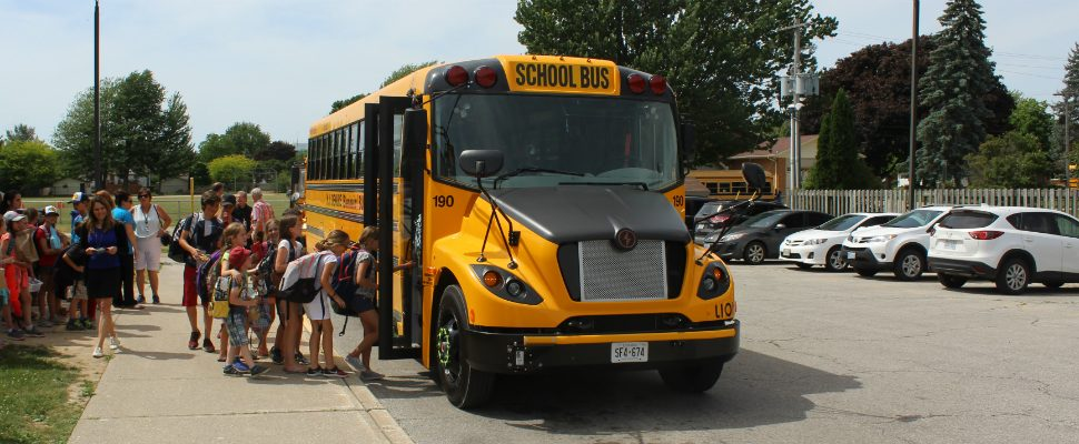 Students at St. Anne Catholic School in Belenheim get to ride the new electric school bus for the first time. June 15, 2018. (Photo by Greg Higgins)