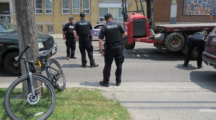 London police investigate a fatal crash involving a cyclist on Adelaide St., north of Dundas St., June 13, 2018. (Photo by Miranda Chant, Blackburn News)