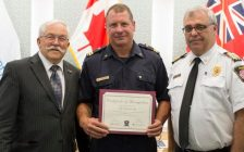 Essex Fire and Rescue Services Captain Joe Meloche receiving an award from Essex Mayor Ron McDermott June 18, 2018. (Photo courtesy of the Town of Essex)