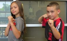 Athena Papadatos and Kaleb Boyle show off their karate moves. The two 8-year-olds from London are training for the World Championships in Dublin, Ireland at the end of October. (Photo by Miranda Chant, Blackburn News)
