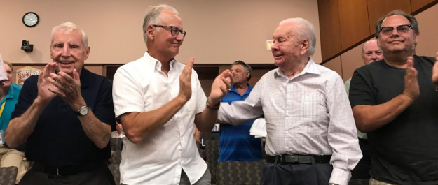 Andy Brandt's friends congratulate him as Sarnia council votes to name Sarnia Bay Marina in his honour. July 16, 2018 (Photo by Melanie Irwin)