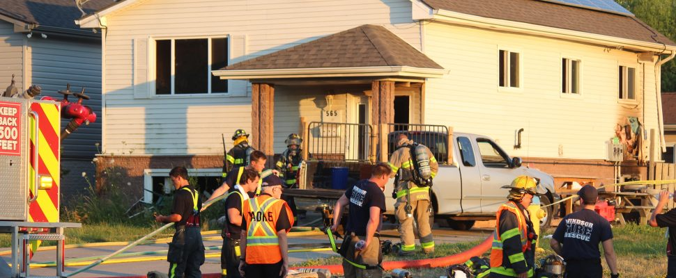 Fire crews respond to a house fire at 565 Memorial Dr. in Windsor, July 9, 2018. (Photo by Mark Brown)