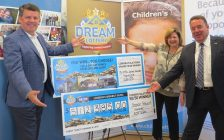 London Health Sciences Foundation President John MacFarlane, St. Joseph's Health Care Foundation President Michelle Campbell, and Children's Health Foundation President Scott Fortnum show off the winning cheques in the 2018 spring edition of the Dream Lottery, July 19, 2018. (Photo by Miranda Chant, Blackburn News)