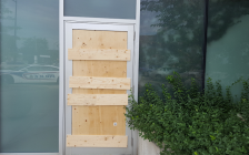 An exit door at London Police Headquarters is boarded up after it was damaged by a man in an attempted break-in, July 26, 2018. Photo courtesy of London police.