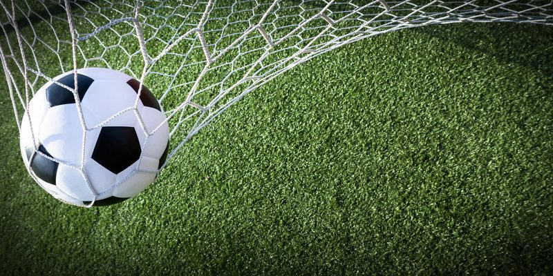 Soccer ball hitting the back of a net. © Can Stock Photo / Suriyaphoto