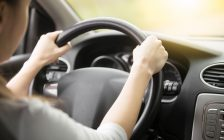 Woman driving car. (Photo courtesy of © Can Stock Photo / fizkes).