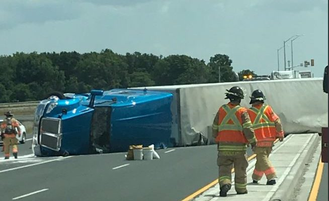 An overturned transport truck blocks Veterans Memorial Parkway on July 11, 2018. Photo courtesy of London police.