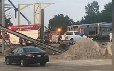 Chatham-Kent fire crews are seen alongside railway tracks and a stopped VIA Rail train in Thamesville on August 12, 2018. Photo courtesy of Dave Goossen/Facebook. Used with permission.
