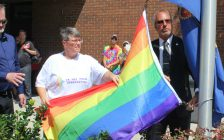 Marianne Willson, president of the CK Gay Pride Association, flies the gay pride flag with Mayor Randy Hope. August 13, 2018. (Photo by Greg Higgins)
