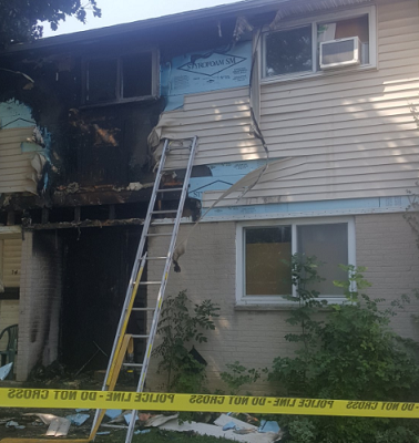 Fire damage to a unit at a townhouse complex on Limberlost Rd. Photo courtesy of @BraveTube