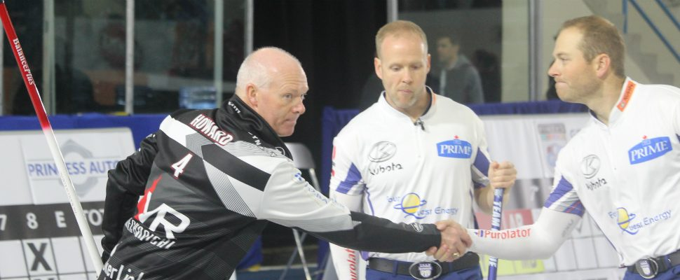 Glenn Howard shakes hands with Team Gushue after a big win int he third draw of the Pinty's Grand Slam of Curling Elite 10. September 27, 2018. (Photo by Greg Higgins)