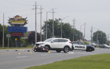 Sarnia police investigate a crash between a motorcycle and SUV on London Line. September 14, 2018 Photo by Melanie Irwin
